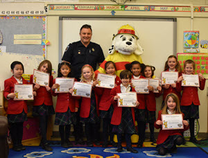image of children and certificates with fire fighter