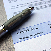 photo of utility bill and pen