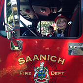 Child waving from fire truck