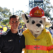 Firefighter with dog mascot