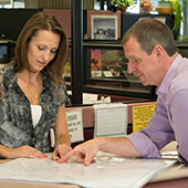 planner and customer reviewing permit