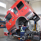 Fire mechanic working on firetruck