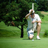 Image of golfer putting