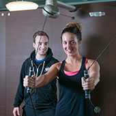 photo of personal trainer with young woman
