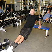 man exercising in weightroom