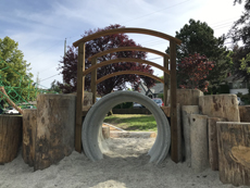 Reynolds Park new play equipment with wooden logs, drainage pipe and bridge