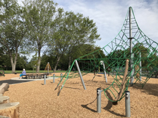 Reynolds Park new play equipment with climber and bench around tree