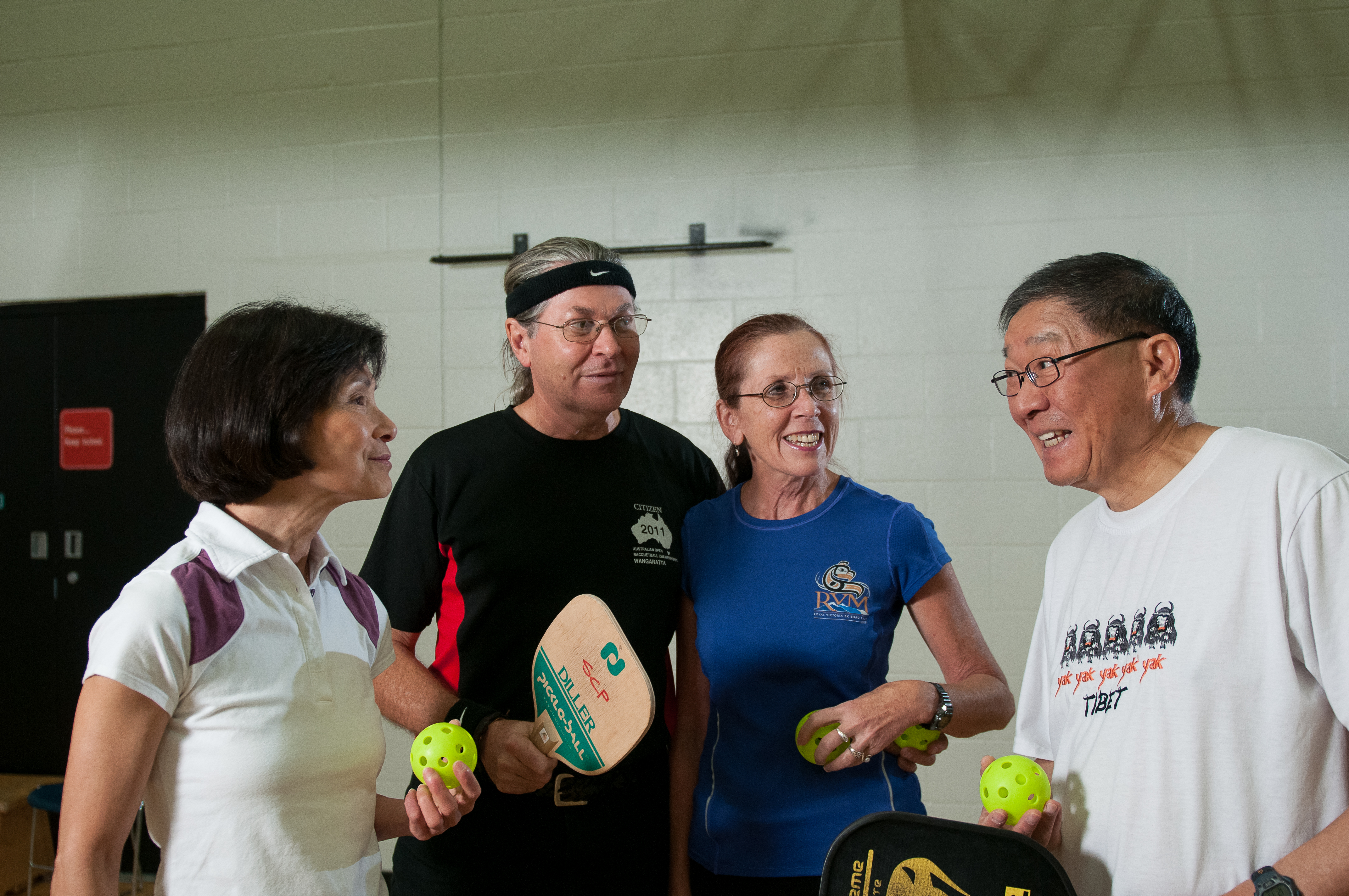photo of adults playing pickleball