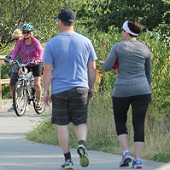 photo of people biking and walking trail